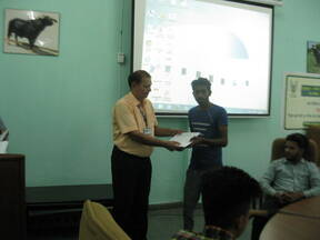 Certificate being given to trainees